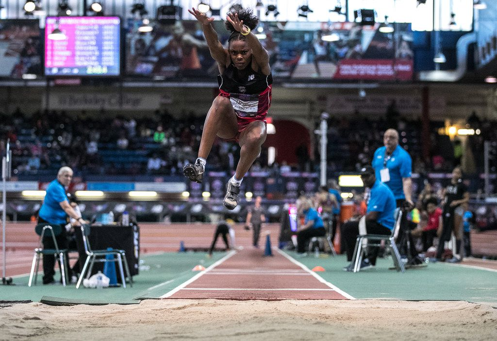 Mansfield Lake Ridge's Jasmine Moore makes an attempt in the girls triple jump finals during the New Balance Nationals Indoor in New York on March 11, 2018. (Jeenah Moon/Special Contributor)