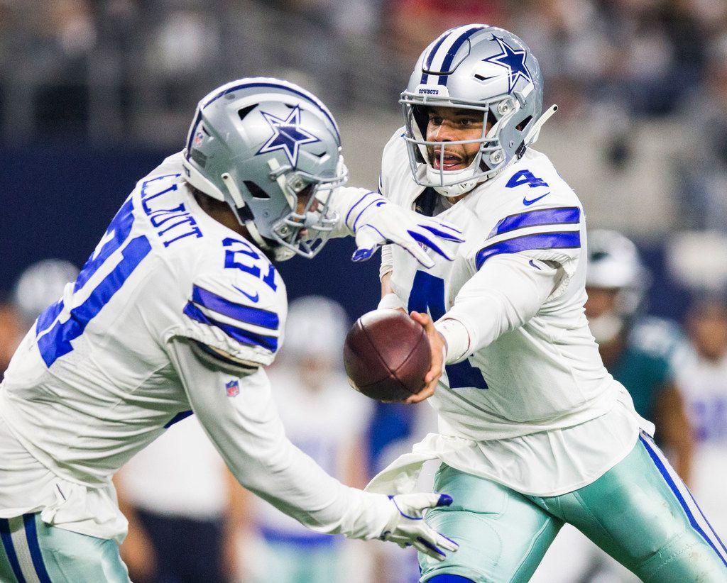 FILE - Cowboys quarterback Dak Prescott (4) hands the ball off to running back Ezekiel Elliott (21) during the third quarter of a game against the Eagles on Sunday, Dec. 9, 2018 at AT&T Stadium in Arlington. (Ashley Landis/The Dallas Morning News)