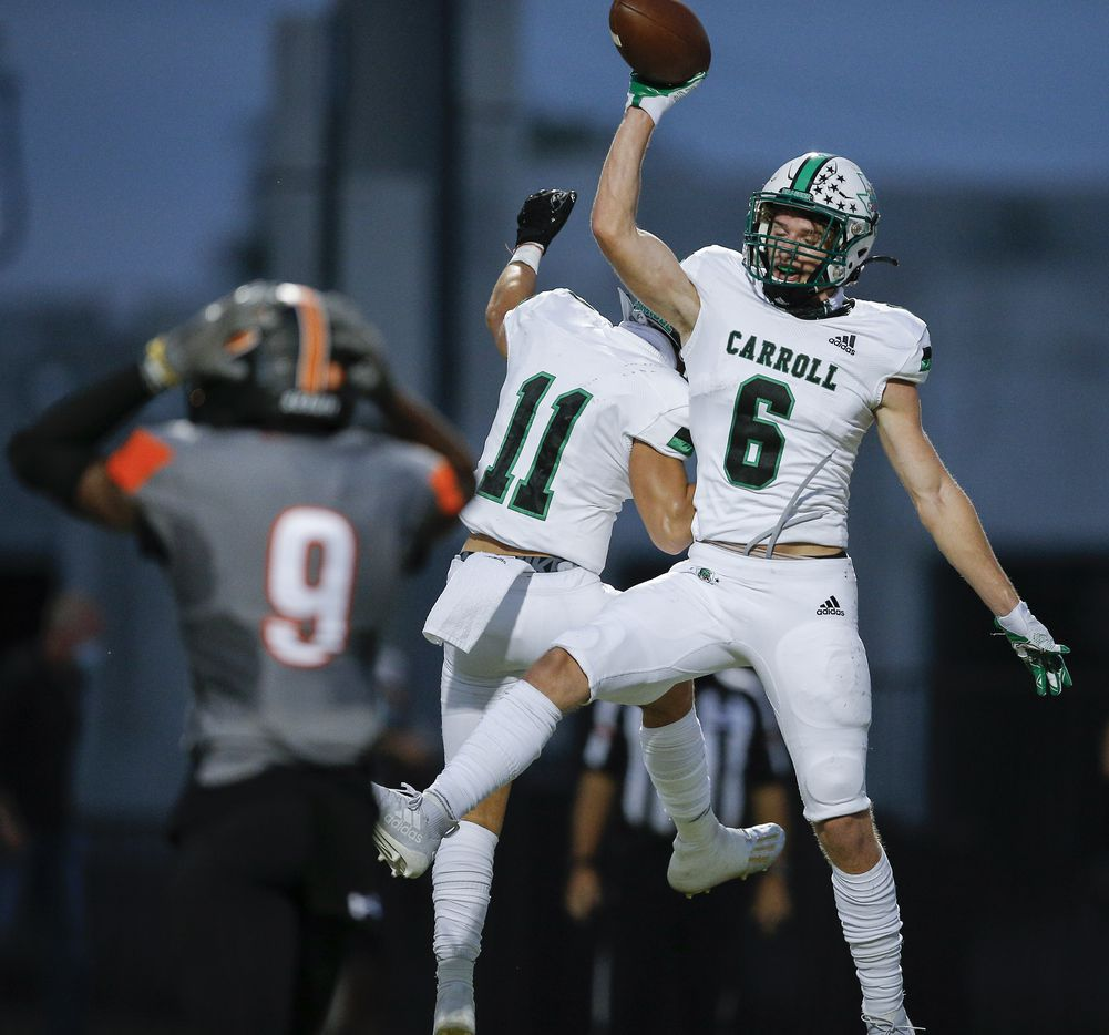 Southlake Carroll junior wide receiver Landon Samson (6) is congratulated by junior wide receiver Josh Spaeth (11) after scoring a touchdown as Rockwall senior defensive back Dariel Brown (9) looks on during the first half of a high school football game at Wilkerson-Sanders Stadium in Rockwall, Thursday, October 8, 2020. (Brandon Wade/Special Contributor)