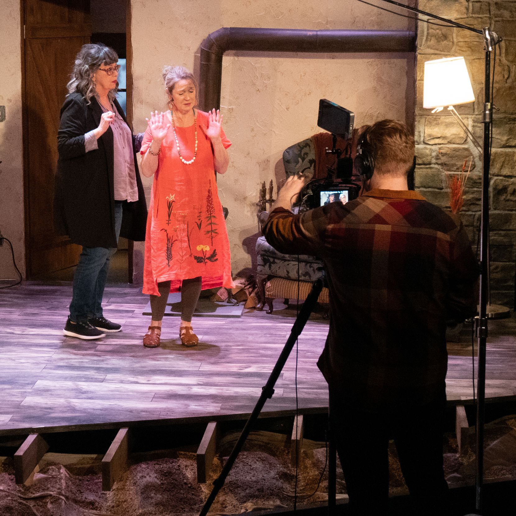 "CJ Critt, left, and Lisa Fairchild star in Stage West Theatre's ""The Children,"" which had to be shut down after its first weekend in the wake of the coronavirus. The production of the play about an environmental disaster was filmed for Stage West by Alex Vorse, behind camera, for online streaming."