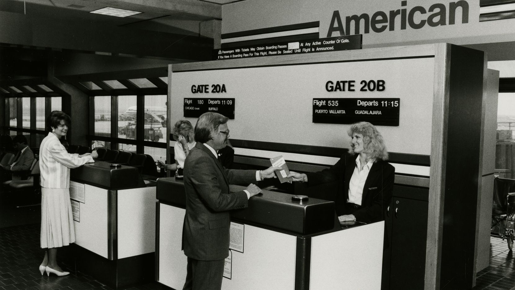American Airlines employees greet passengers at DFW International Airport in 1981.