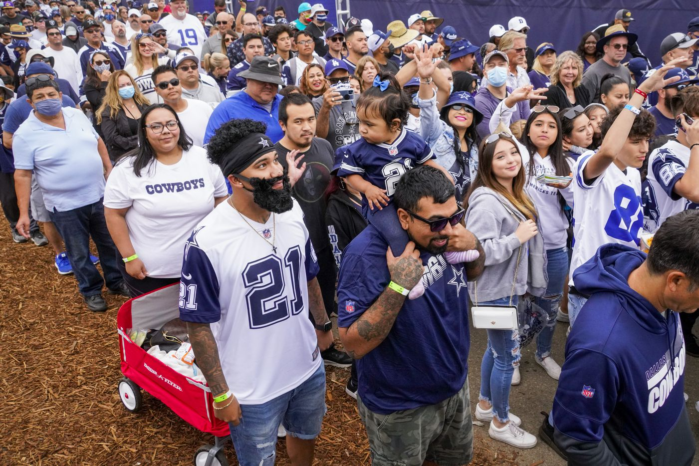 Fans enter the facility as the gates open for the Dallas Cowboys opening ceremonies before a practice at training camp on Saturday, July 24, 2021, in Oxnard, Calif.