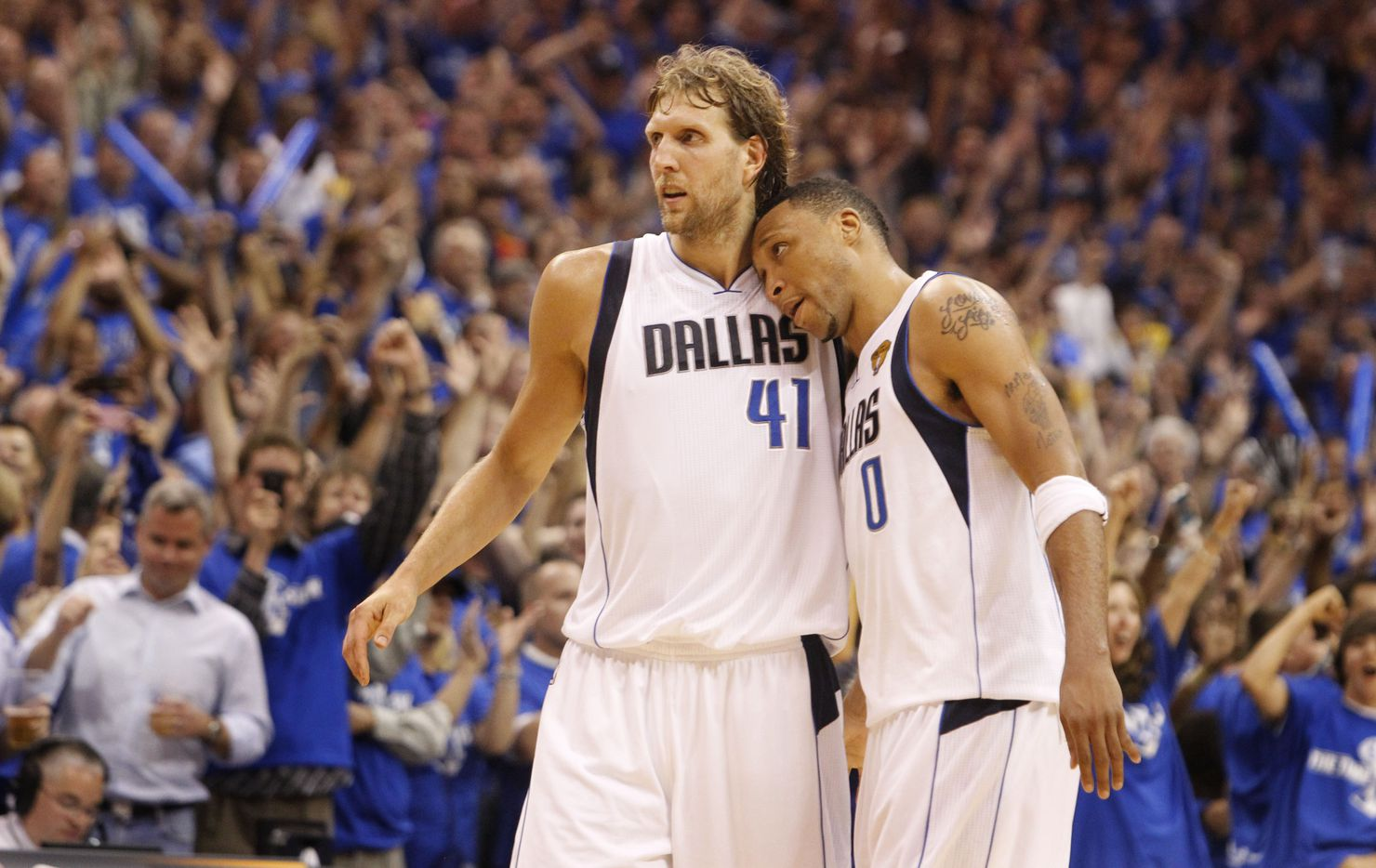 Dallas Mavericks power forward Dirk Nowitzki (41) and Dallas Mavericks small forward Shawn Marion (0) share a close moment after the final seconds tick off the clock at the end of the game in game five of the NBA Finals against the Miami Heat at American Airlines Center Thursday, June 9, 2011 in Dallas. The Mavericks won 112-103 to take a 3-2 lead in the series. (Louis DeLuca/The Dallas Morning News) 06142011xMAVSspecial