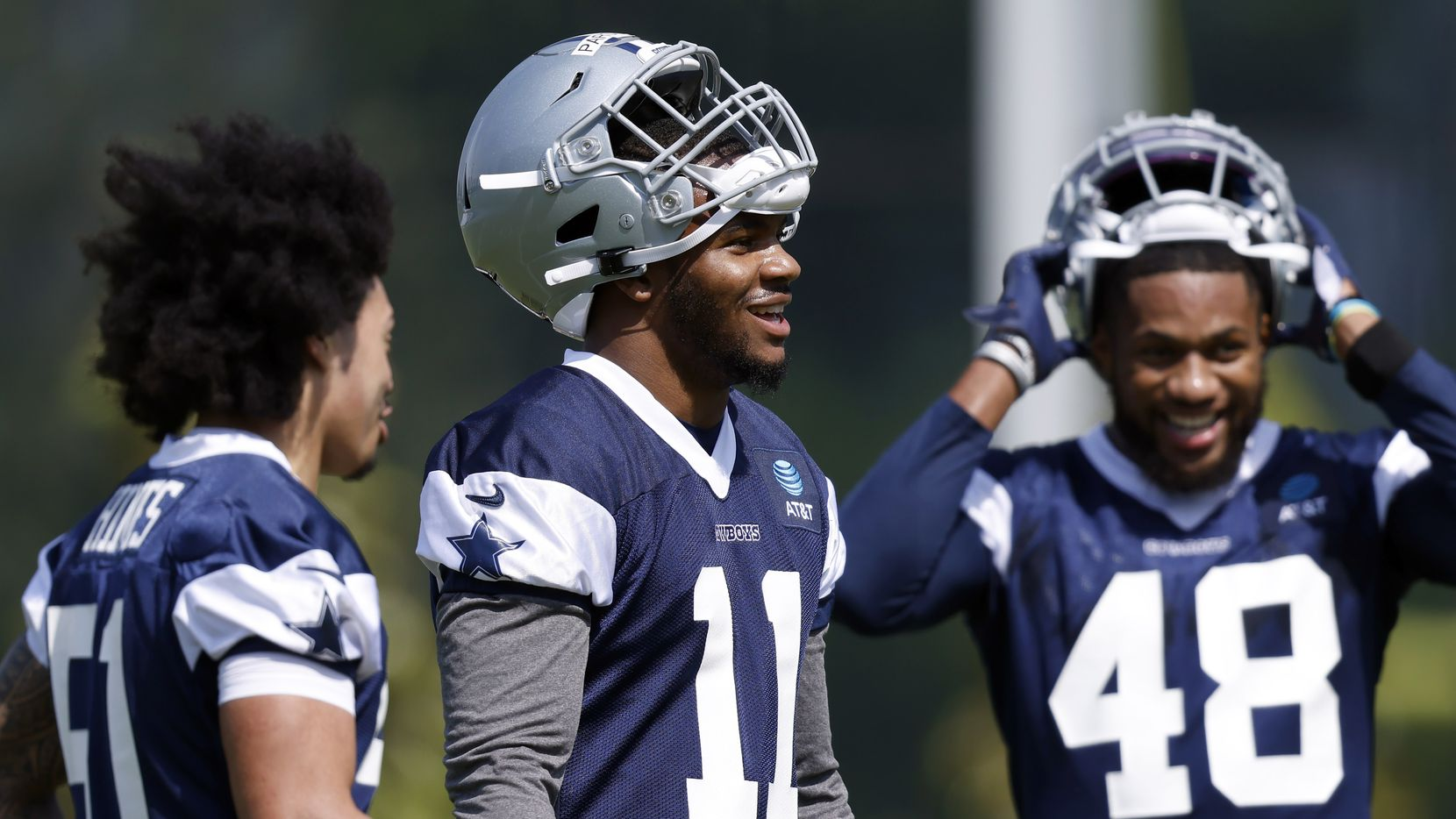 Dallas Cowboys first round linebacker Micah Parsons (11) laughs with teammates Anthony Hines (left) and Gabriel Cox (48) during rookie minicamp at the The Star in Frisco, Texas, Saturday, May 15, 2021.