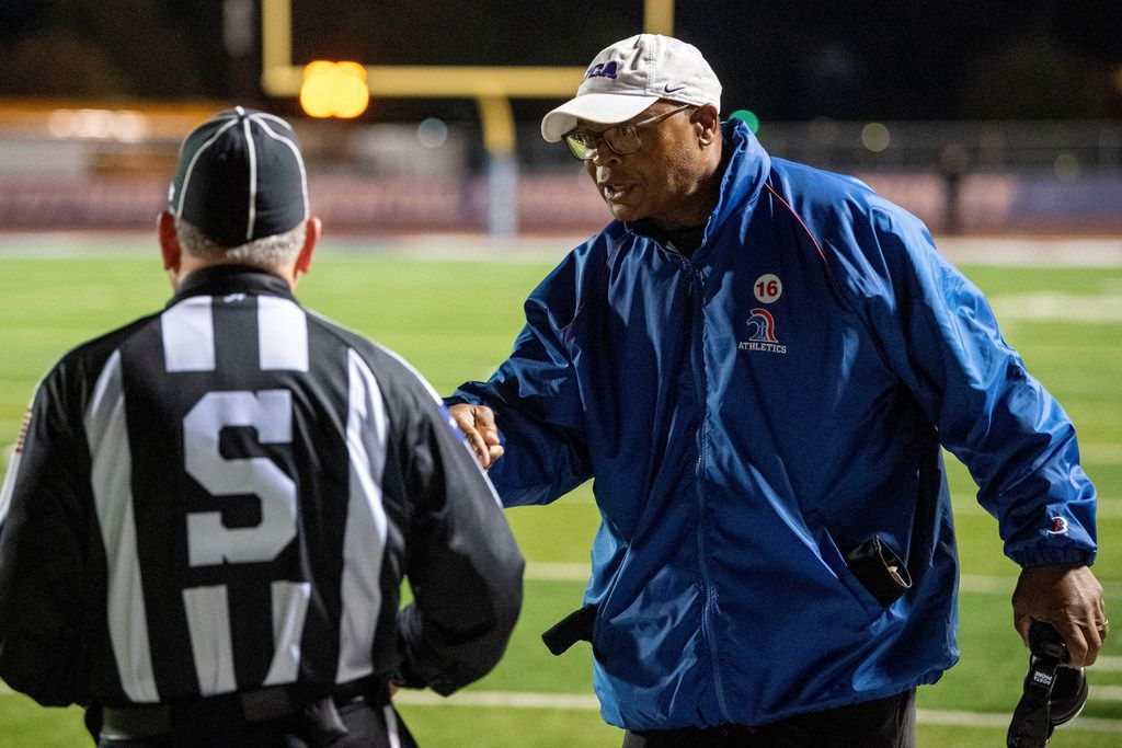 TCA-Addison head coach and NFL Hall of Famer Mike Singletary disputes a call with a referee in the first half of a high school football game against Fort Worth Nolan on Friday, November 8, 2019 at Tom Landry Stadium in Addison, Texas.