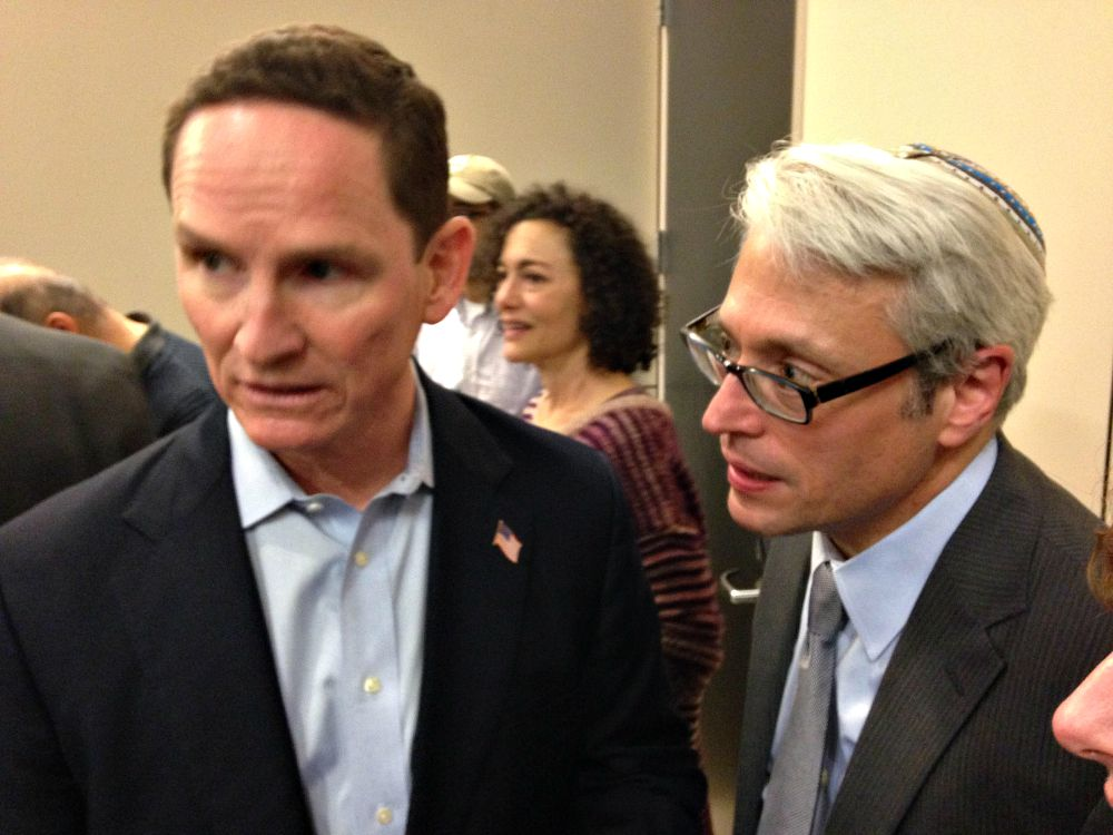 Dallas County Judge Clay Jenkins, at left, and Rabbi David Stern of Temple Emanu-El visited with attorneys and families of those being detained because of the president's executive order signed Friday.