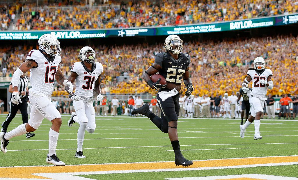 Baylor running back Terence Williams (22) scores a 23-yard touchdown past Oklahoma State safety Jordan Sterns (13), safety Tre Flowers (31) and linebacker Jordan Burton (20) during the first quarter at McLane Stadium in Waco, Texas, Saturday, Sept. 24, 2016. (Jae S. Lee/The Dallas Morning News)