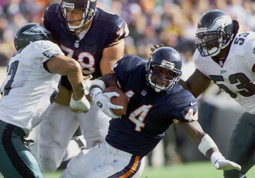 Chicago Bears running back Curtis Enis (44) is tackled after a 4-yard gain by Philadelphia Eagles defenders James Darling, left, and Hugh Douglas (53) in the second half of the Eagles' 20-16 win on Sunday, Oct. 17, 1999, in Chicago. Helping Enis on the play is Bears tackle Blake Brockermeyer (78).