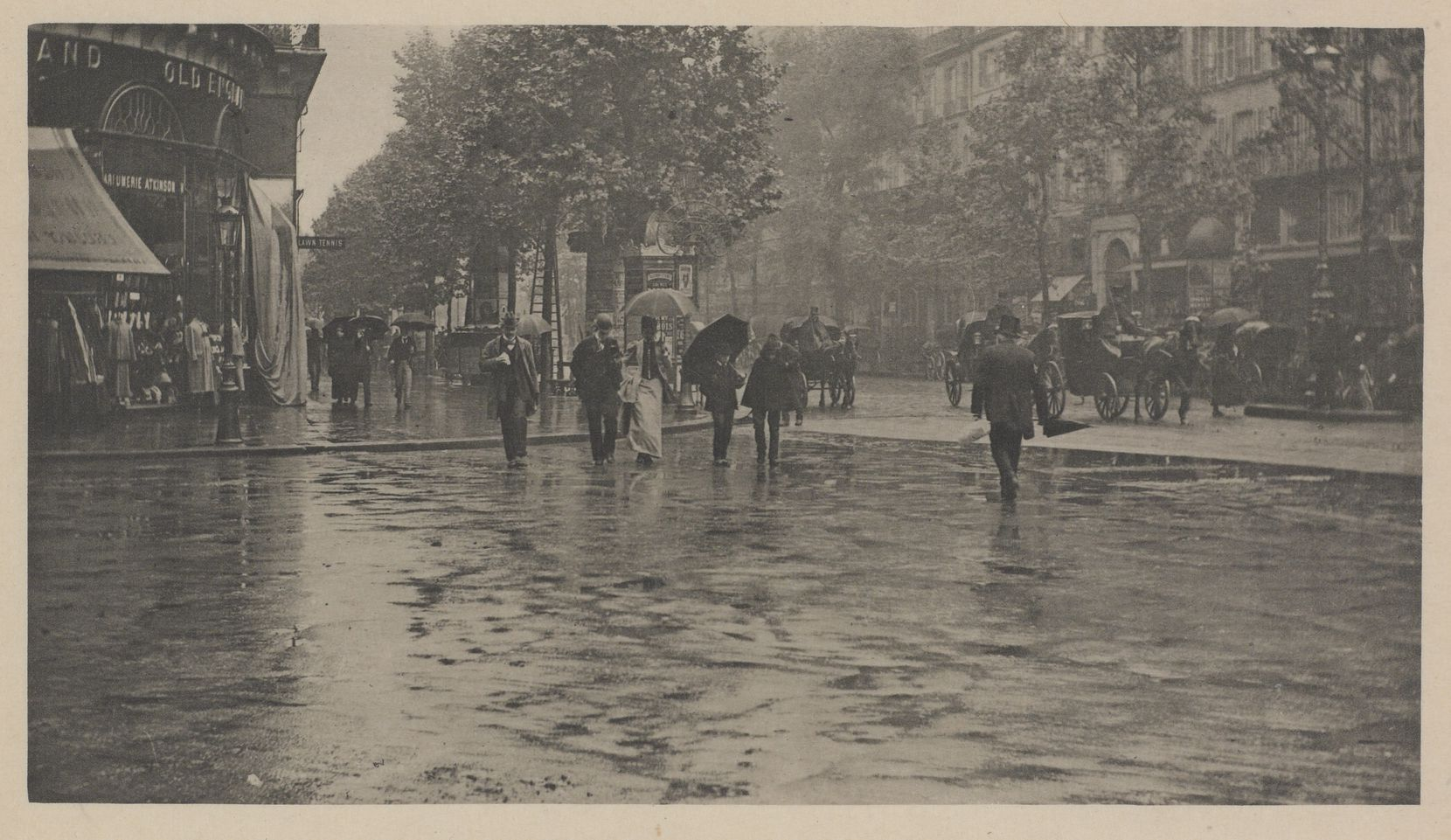 """The show opens with renowned American photographer Alfred Stieglitz's 1894 work """"A Wet Day on the Boulevard, Paris."""""""