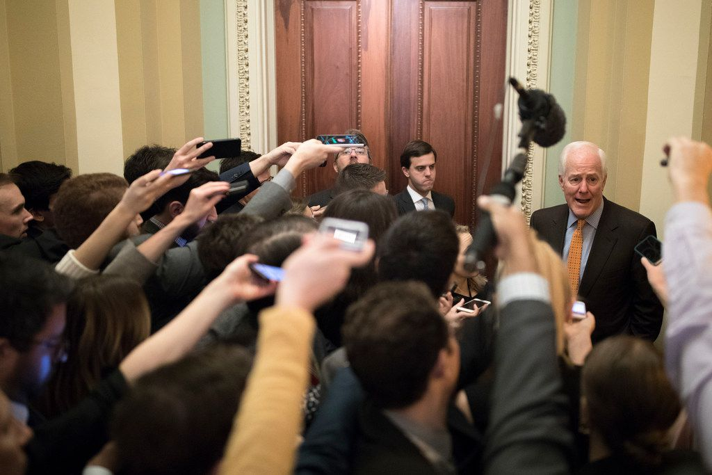 Sen. John Cornyn speaks to reporters on Capitol Hill in Washington on Friday as the Senate is heading toward a showdown vote on legislation to keep the government open past midnight.