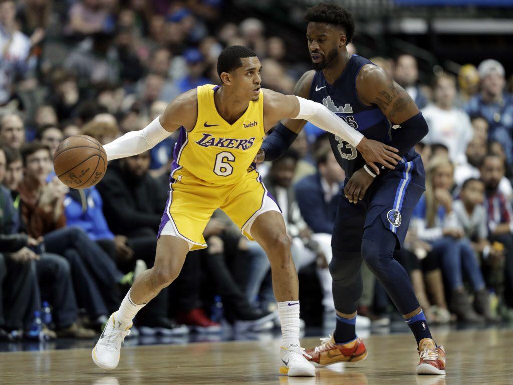 Los Angeles Lakers guard Jordan Clarkson (6) works against Dallas Mavericks' Wesley Matthews, right, in the second half of an NBA basketball game, Saturday, Jan. 13, 2018, in Dallas. (AP Photo/Tony Gutierrez)