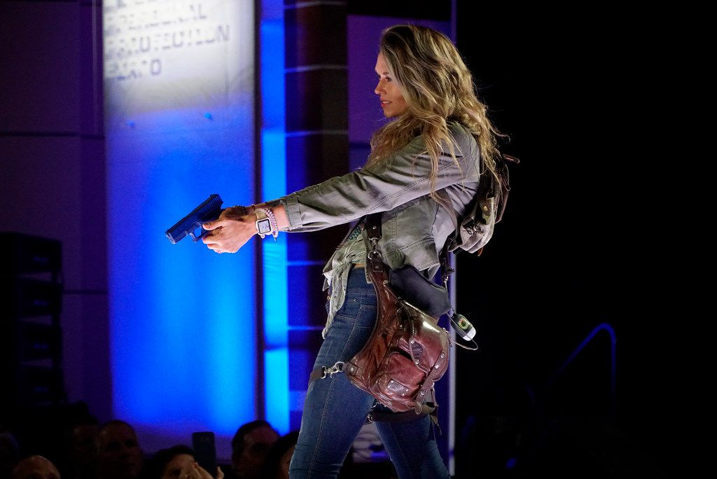 """Models showed off a variety of ways to carry a concealed fire arm at a """"concealed carry fashion show"""" on Friday at an NRA expo."""