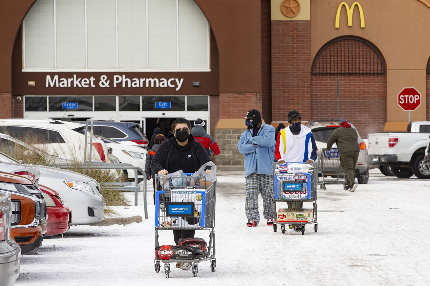 People shop at Walmart in Arlington on Tuesday, Feb. 16, 2021. (Juan Figueroa/ The Dallas Morning News)