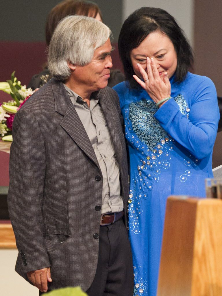 "In this Sunday, June 3, 2012 file photo, Associated Press staff photographer Nick Ut, left, meets Phan Thi Kim Phuc during a presentation at the Liberty Baptist Church in Newport Beach, Calif. ""That picture changed my life. It changed Kim's life,"" he says of the pair's chance meeting in a dusty Vietnamese village called Trang Bang."