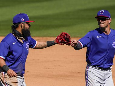 Texas Rangers third baseman Rougned Odor (left) celebrates with second baseman Nick Solak after a defensive play during the fourth inning of a spring training game against the Arizona Diamondbacks at Salt River Fields at Talking Stick on Saturday, March 6, 2021, in Scottsdale, Ariz.