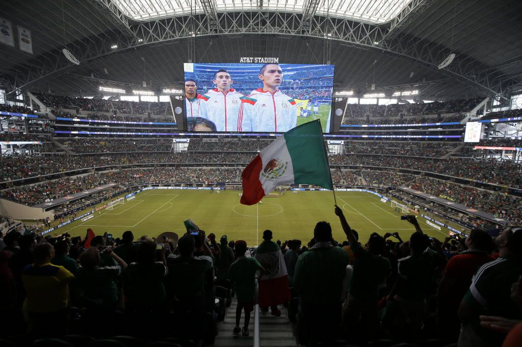 FILE — A Mexico fan waves a national flag during the playing of the Mexican national anthem at AT&T stadium before their friendly soccer match against Ecuador, Saturday, May 31, 2014, in Arlington, Texas.