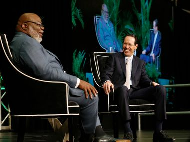 Bishop T.D. Jakes (left) and AT&T Chairman and CEO Randall Stephenson share a laugh as they talk about how they're working together to help ex-offenders re-enter the workforce during a fireside chat at The Potter's House in Dallas on Wednesday, April 17, 2019. The effort is part of an AT&T initiative to fight homelessness, which is higher among people who have a criminal history and can't get back into work. (Vernon Bryant/The Dallas Morning News)