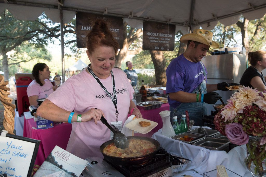 Janice Provost, owner and head chef of Parigi, prepares shrimp and grits during Chefs for Farmers.