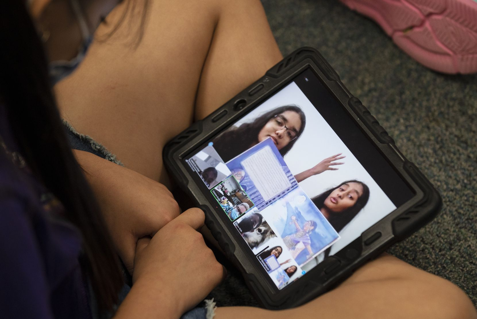 Coppell high school juniors Aarushi Jaiswal, left, and Veda Kanamarlapudi, seen on a tablet, read an Indian folktale titled Sukhu and Dukhu using Zoom, to a dual language elementary students at W.H. Wilson Elementary in Coppell, on Monday, April 19, 2021. The Coppell high school juniors are translating Indian children stories into Spanish so dual language students can understand it.