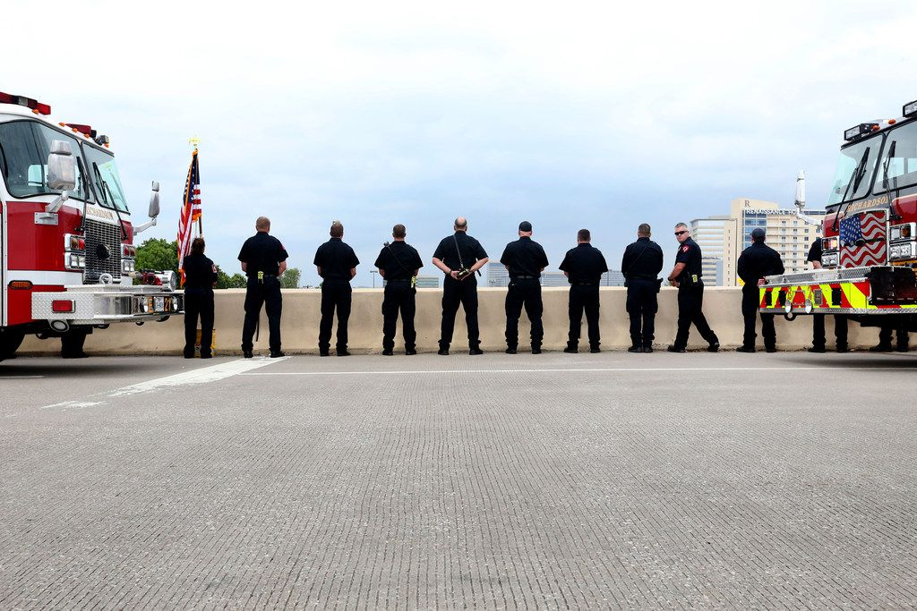 Richardson firefighters and police officers gather for the funeral procession for Dallas police Officer Rogelio Santander on North Central Expressway and Galatyn Parkway in Richardson, Texas on Tuesday, May 1, 2018. Santander was shot and killed last week while trying to arrest a man at a Home Depot.