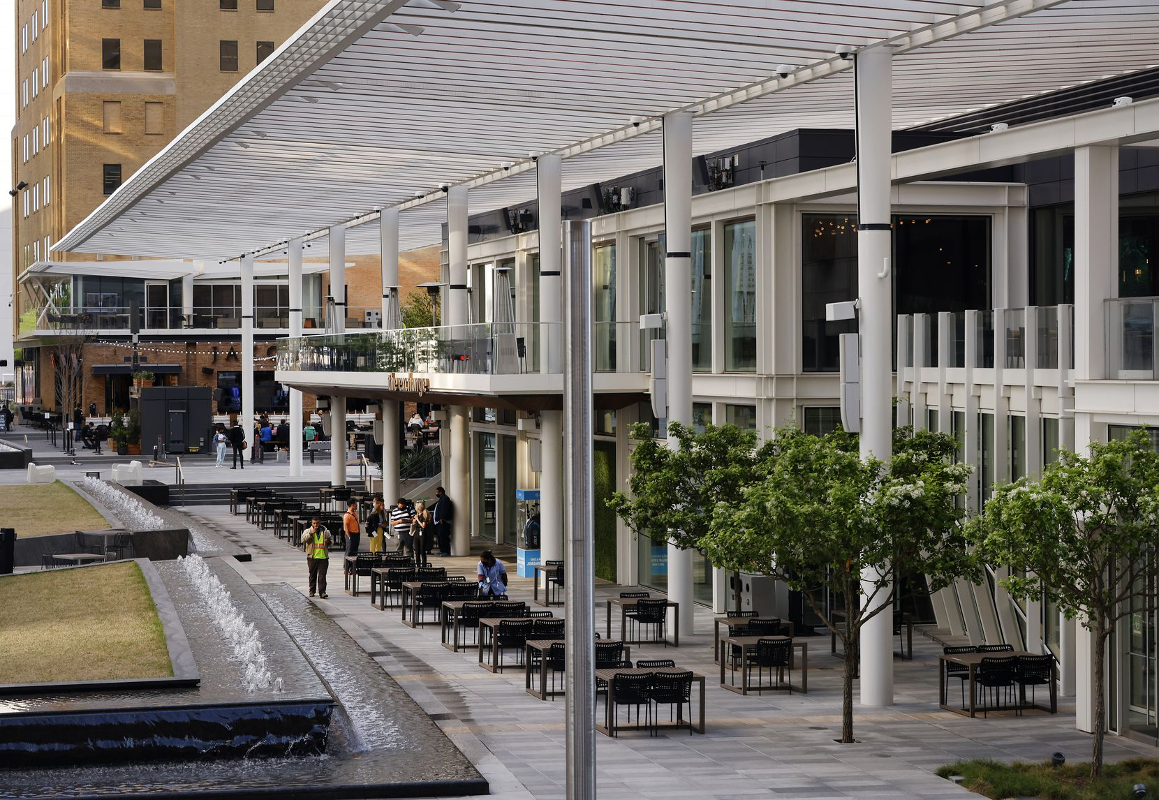 Steel trellises cover the outdoor dining area of the The Exchange food hall in the new AT&T Discovery District in downtown Dallas, Tuesday, April 20, 2021.