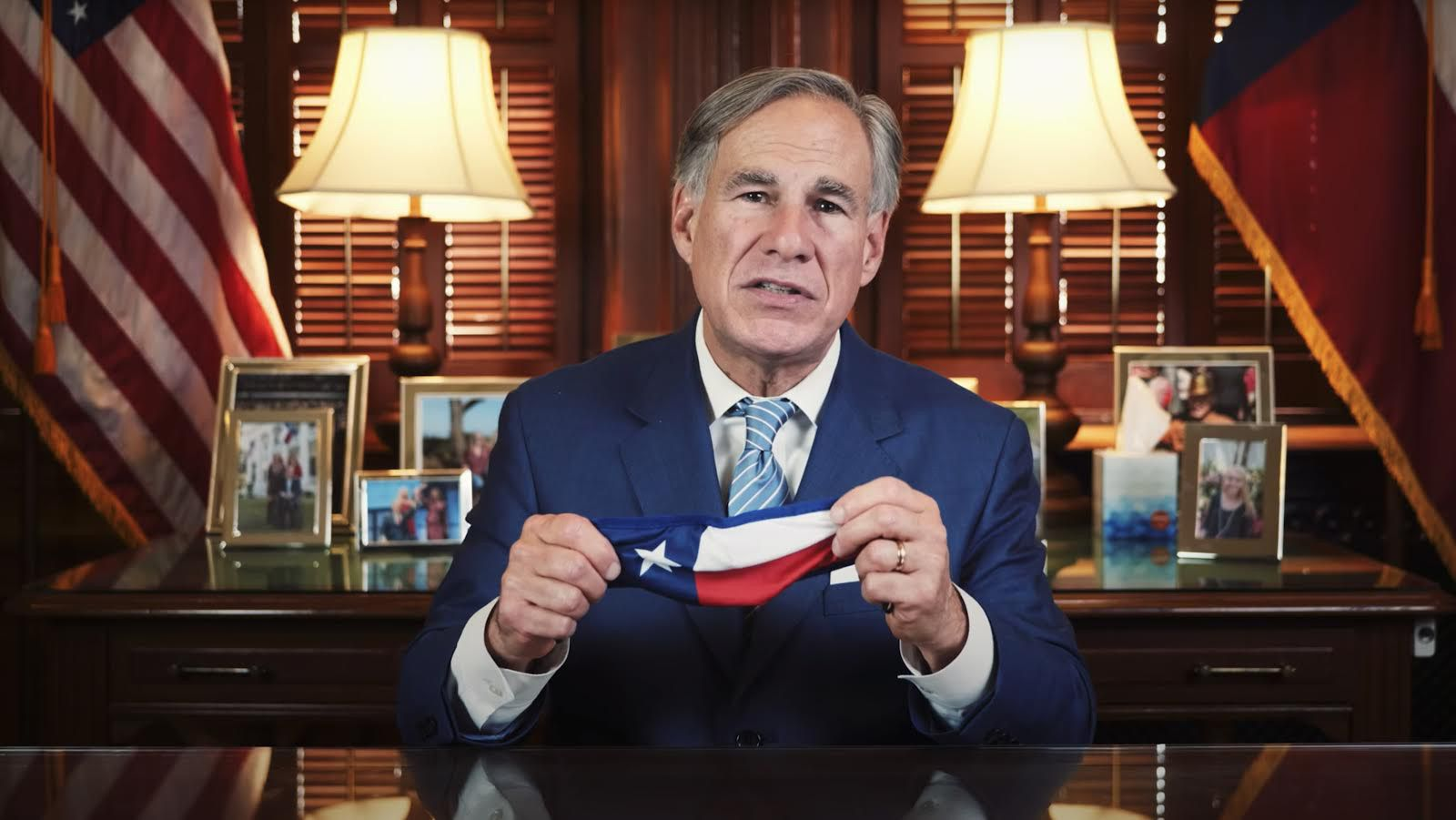 Texas Governor Greg Abbott holds up a mask during his state mandate that requires all Texans to wear a mask to help fight the spread of coronavirus. Abbott made the announcement on Thursday, July 2, 2020 from Austin, Texas. (Screen shot from Abbott's YouTube channel)