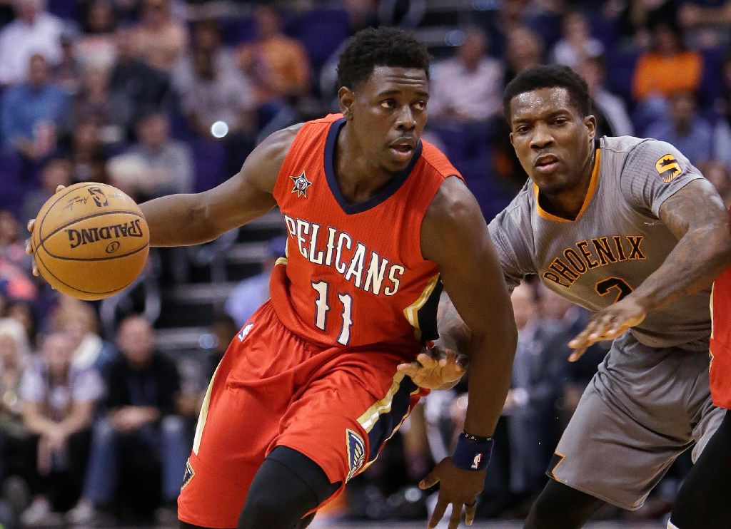New Orleans Pelicans guard Jrue Holiday (11) could be an attractive free-agent target for the Mavericks next month. (AP Photo/Rick Scuteri, File)