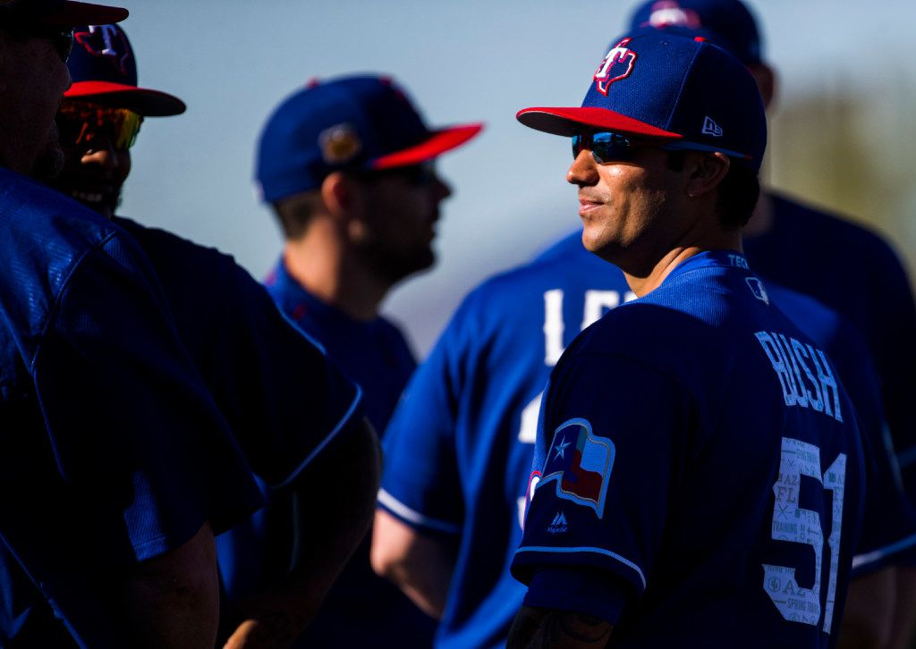 Texas Rangers relief pitcher Matt Bush (51) talks with teammates during a spring training workout at the team's training facility on Tuesday, February 15, 2017 in Surprise, Arizona. (Ashley Landis/The Dallas Morning News)
