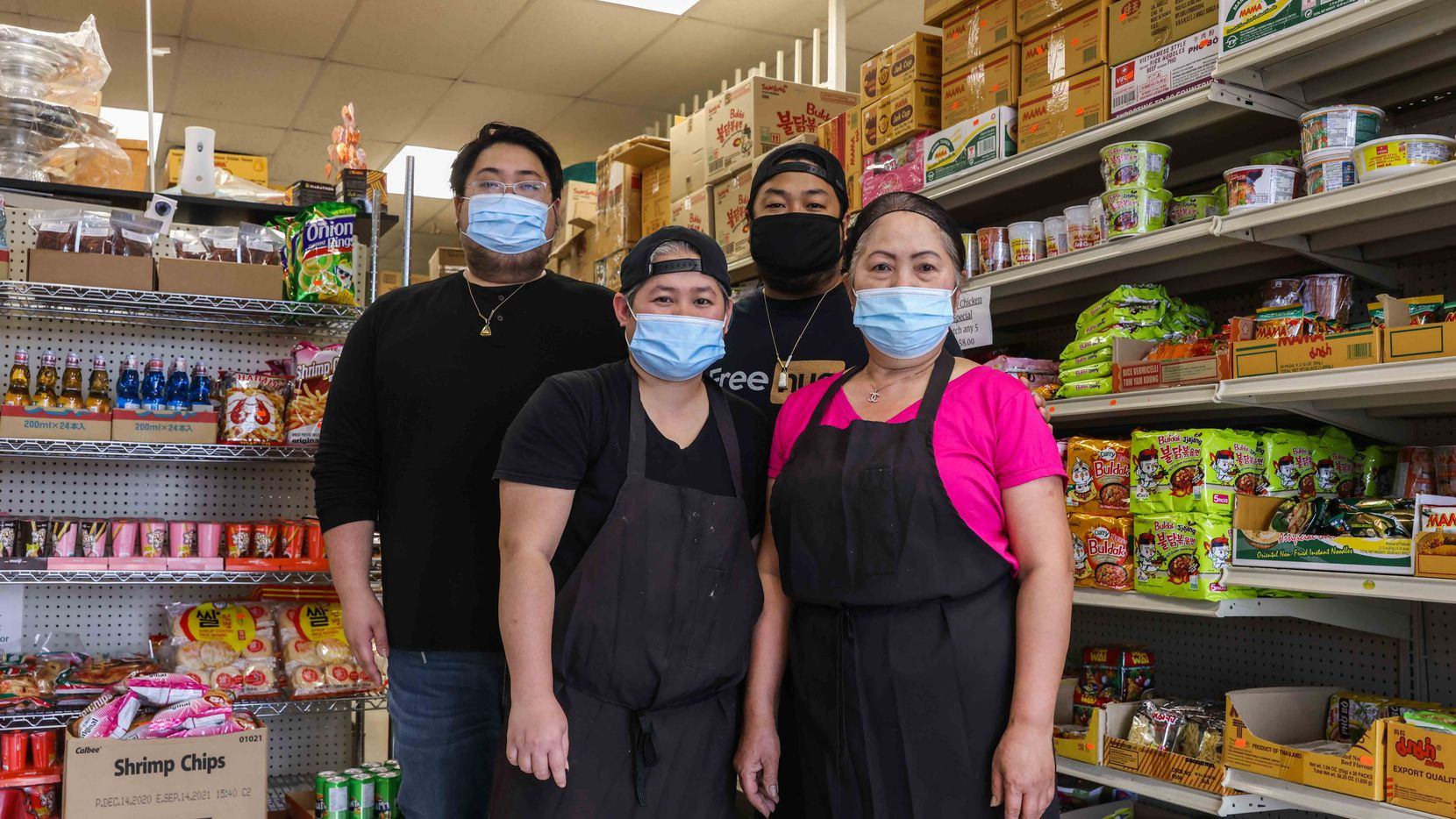 From left, Phillip Southammavong, Peck Somphavanh, Alen Southammavong and Ly Southammavong pose together at Ly Food Market in Oak Cliff on Tuesday, April 6, 2021.