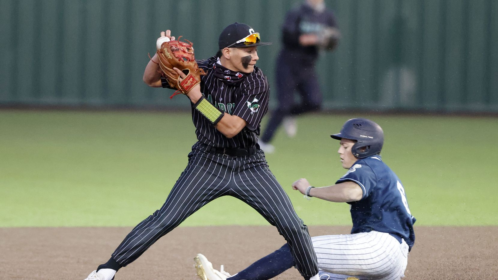 Southlake's Ethan Mendoza forces out Keller's Griffin Barton (6) during the fourth inning of their District 4-6A baseball game Friday. Southlake Carroll won 3-0. (Michael Ainsworth/Special Contributor)