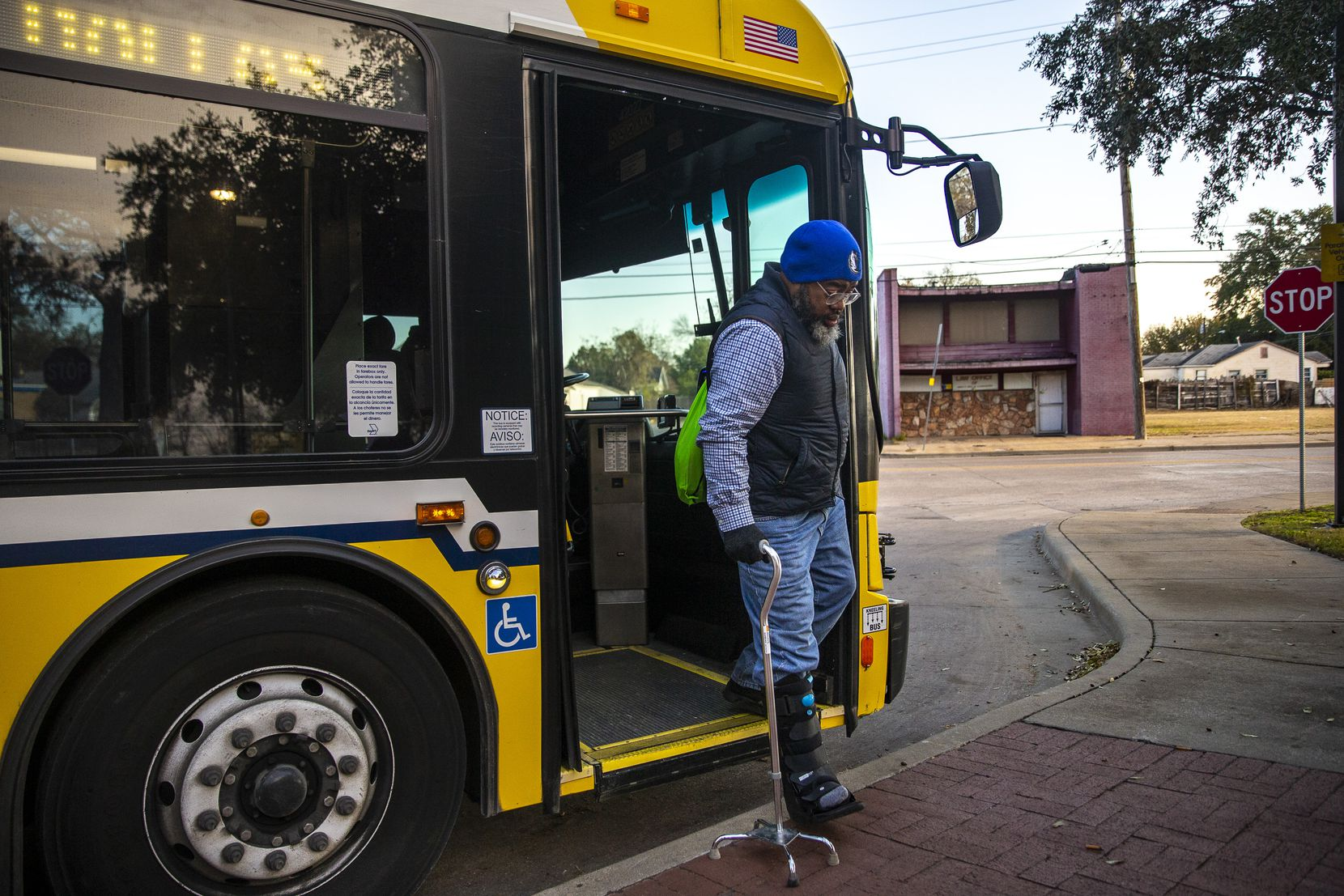 Randy eased himself off one of several DART buses he took to get to an appointment at the Social Security Administration building in Fair Park in Dallas on Nov. 14, 2019. After a heart attack and stroke left him disabled earlier that year, he had to navigate a tangled web of social services to secure housing and medical needs.