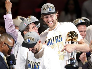 Dallas Mavericks Dallas Mavericks power forward Dirk Nowitzki (41) holds the Bill Russell NBA Finals MVP trophy as he, Dallas Mavericks owner Mark Cuban, Dallas Mavericks point guard Jason Kidd (2) (front left) and others celebrate after the Mavs won the NBA Championship by winning game six of the NBA Finals between the Miami Heat and the Dallas Mavericks at the American Airlines Arena in Miami, Florida, June 12, 2011.  The Mavericks won 105-95 to take the title.