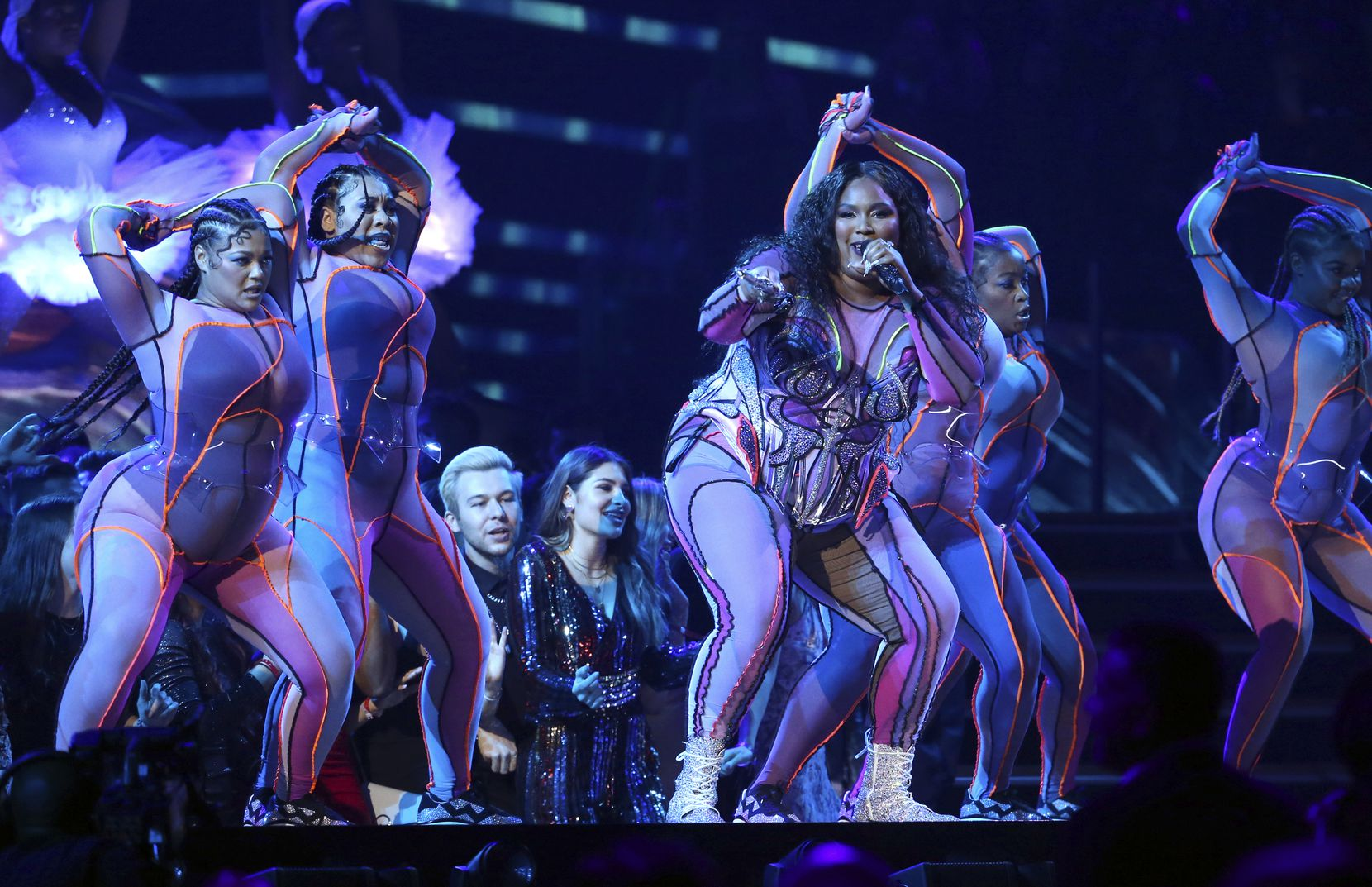 Lizzo, center, performs at the 62nd annual Grammy Awards on Sunday, Jan. 26, 2020, in Los Angeles.