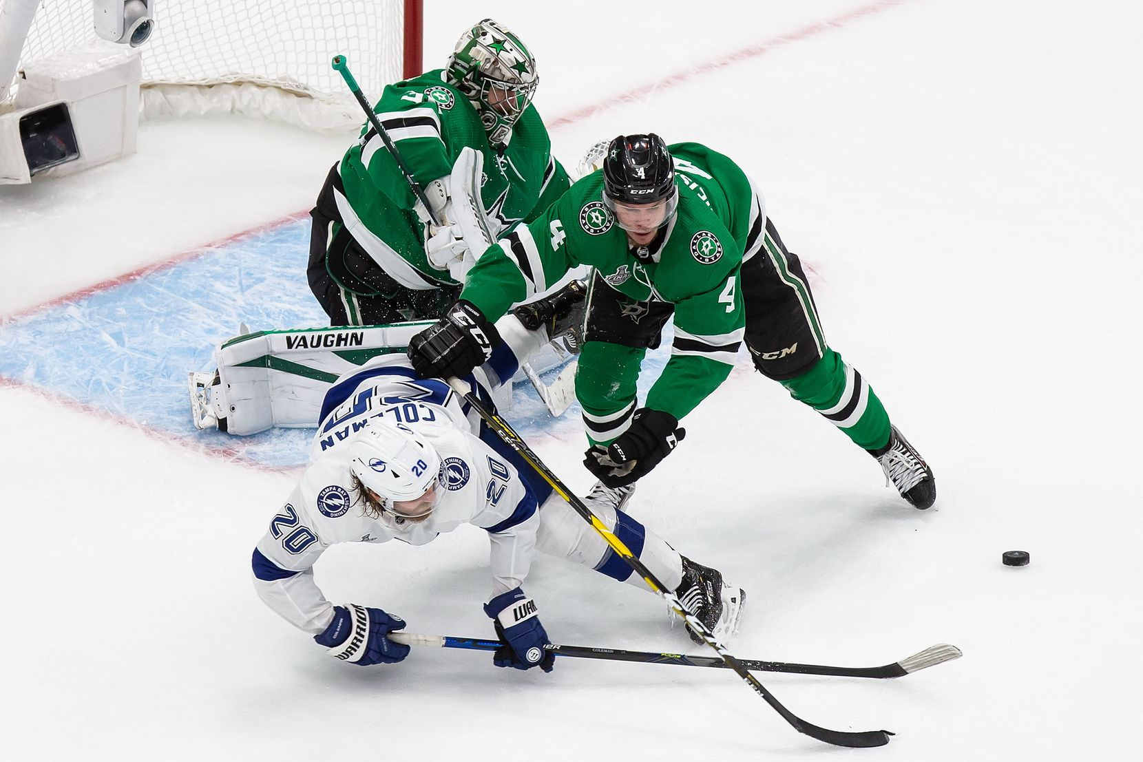 Miro Heiskanen (4) of the Dallas Stars battles against Blake Coleman (20) of the Tampa Bay Lightning during Game Four of the Stanley Cup Final at Rogers Place in Edmonton, Alberta, Canada on Friday, September 25, 2020. (Codie McLachlan/Special Contributor)
