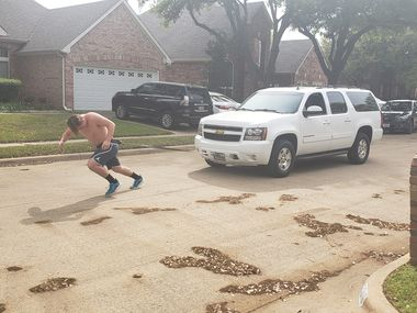 Flower Mound defensive tackle Colton Vatne pulls his mother's Suburban as a form of strength training while gyms and school weight rooms are closed because of the coronavirus outbreak. (Courtesy photo from Brandee Vatne)