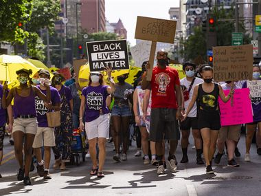 Protestors march during the Not My Son's rally against police brutality and racial injustice on July 4, 2020 in downtown Dallas. (Juan Figueroa/ The Dallas Morning News)