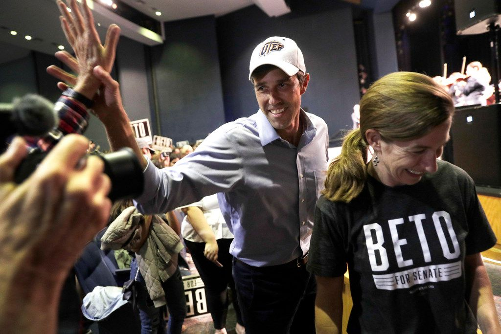O'Rourke with his wife Amy, right, arrives for the campaign rally.