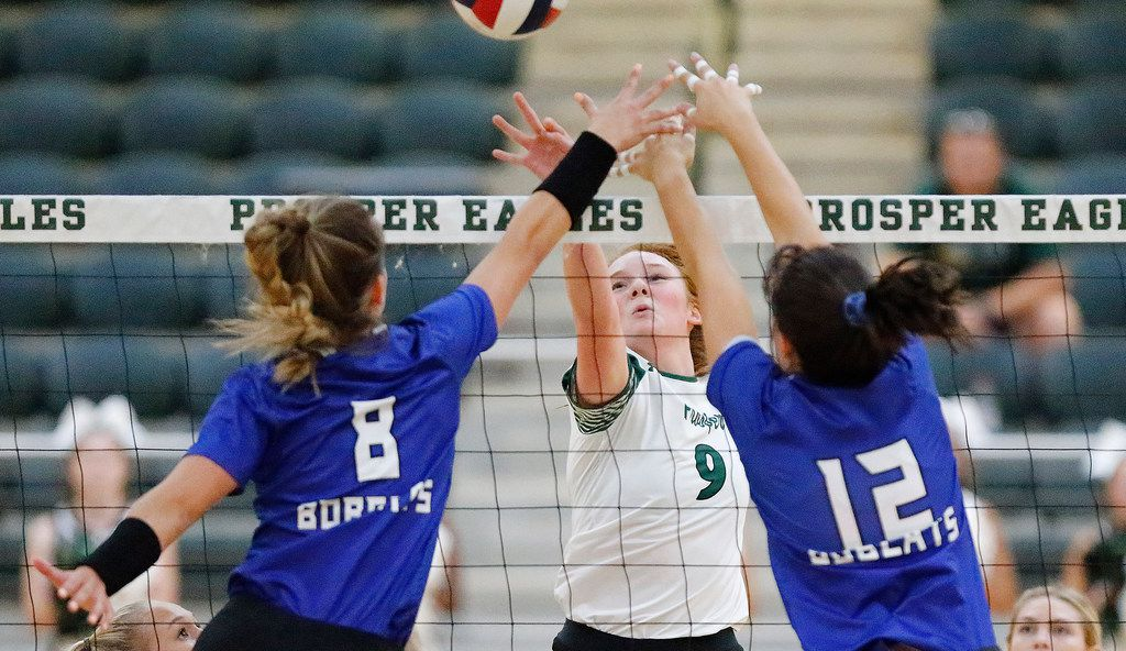 Trophy Club Byron Nelson's Paige Flickinger (8) and Payton Chamberlain (12) try to block a shot by Prosper's Ella Chaney during a match on August 20, 2019. (Stewart F. House/Special Contributor)