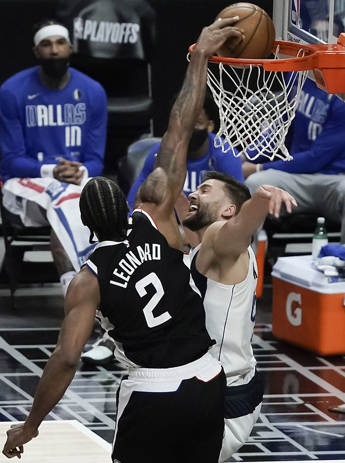 LA Clippers forward Kawhi Leonard (2) dunks the ball past Dallas Mavericks forward Maxi Kleber (42) during the second half of an NBA playoff basketball game at Staples Center on Saturday, May 22, 2021, in Los Angeles.