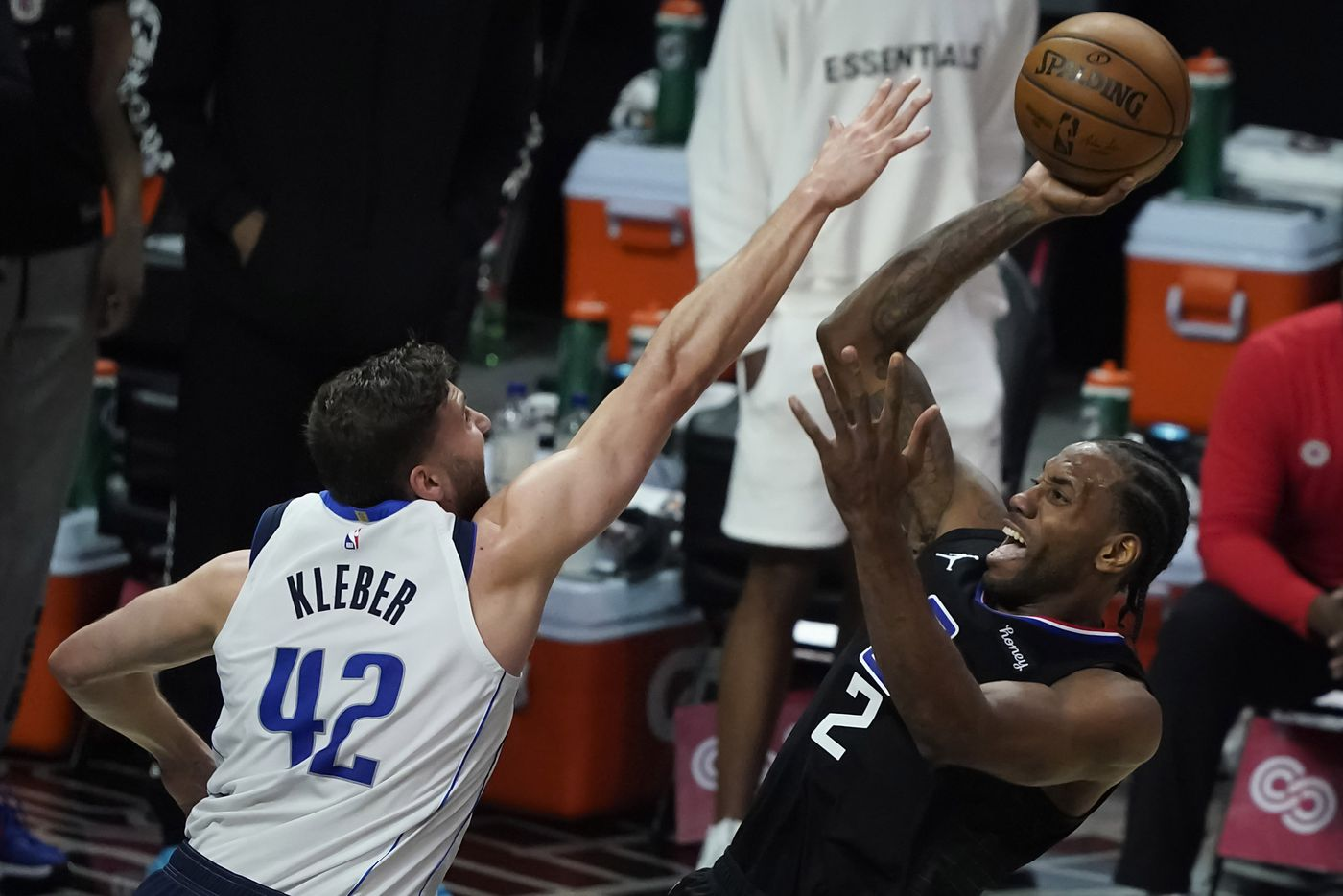 LA Clippers forward Kawhi Leonard (2) shoots over Dallas Mavericks forward Maxi Kleber (42) during the first half of an NBA playoff basketball game at Staples Center on Tuesday, May 25, 2021, in Los Angeles.