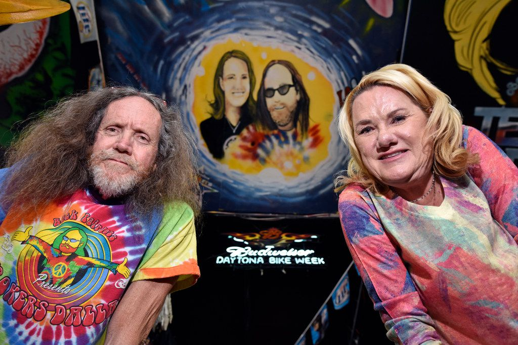 Owner Rick Fairless and his wife, Susan Fairless, shop manager, are shown with a mural of the couple painted on the ceiling of the shop inside Strokers Dallas.
