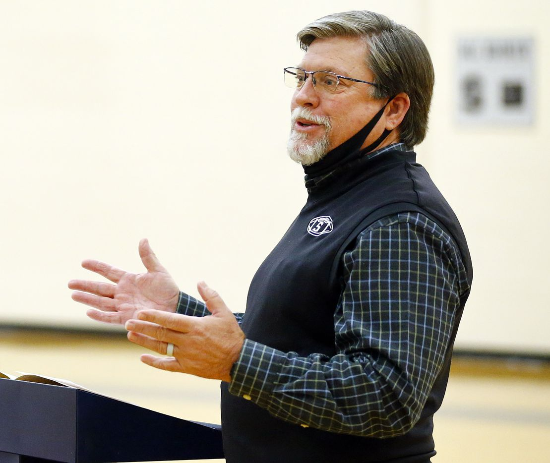 Fort Worth All Saints' Episcopal School Athletics Director/Head Football Coach Aaron Beck speaks during national letters of intent signing day in the schools gymnasium, Wednesday, December 16, 2020. (Tom Fox/The Dallas Morning News)