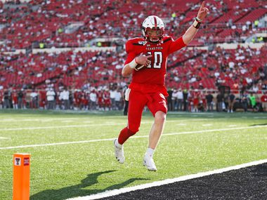 Texas Tech's Alan Bowman (10) scores a touchdown against Montana State during the second half of an NCAA college football game Saturday, Aug. 31, 2019, in Lubbock, Texas.