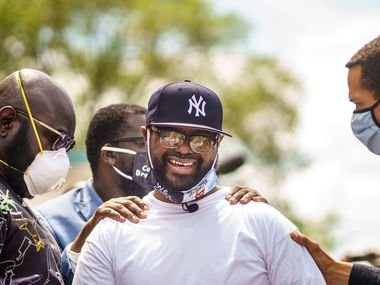 Terrence Floyd(C), the brother of George Floyd, an unarmed black man who died while being arrested and pinned to the ground by the knee of a Minneapolis police officer, gathers with supporters at the site where George Floyd died on June 1, 2020, in Minneapolis, Minnesota.