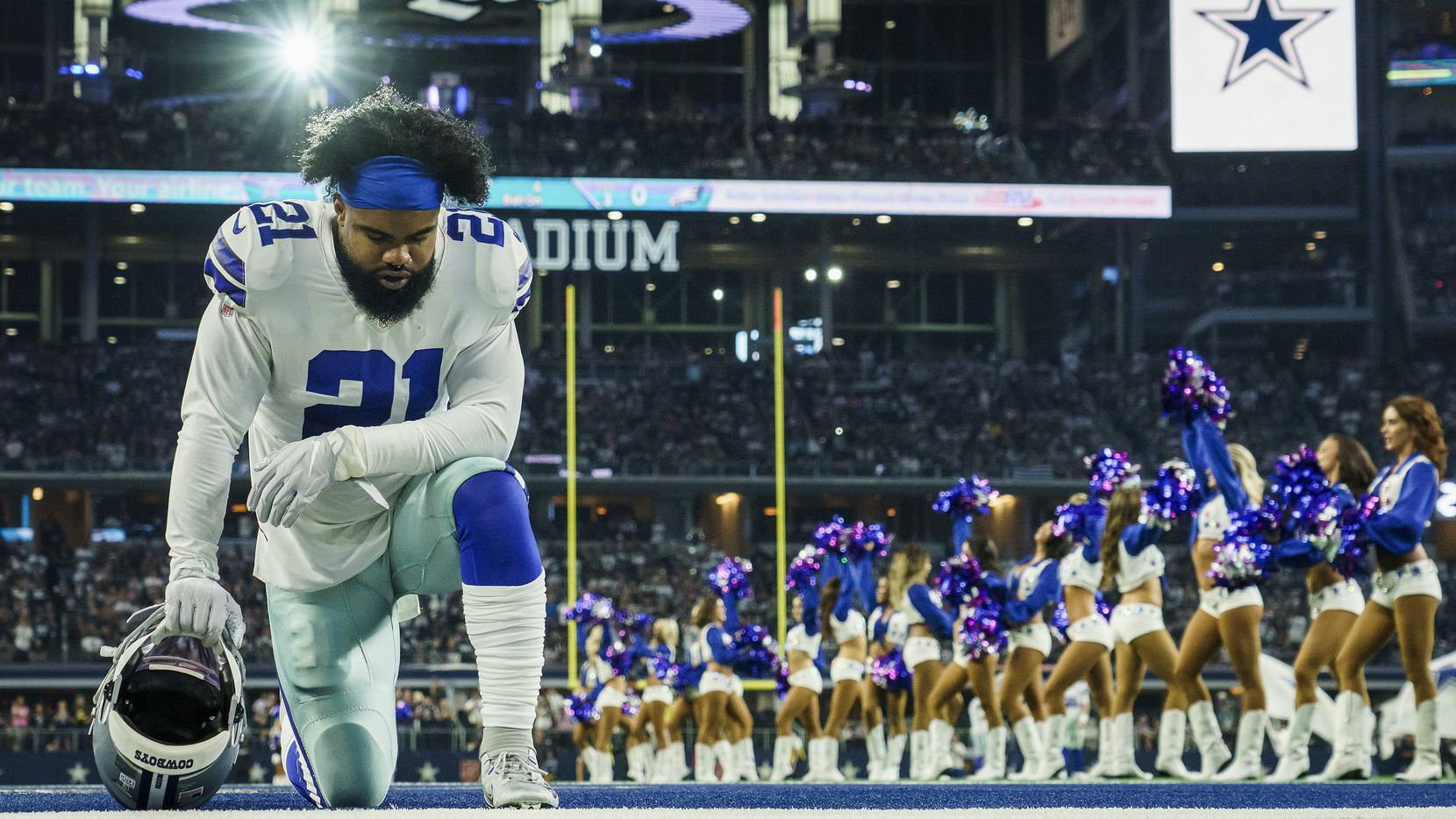 Dallas Cowboys running back Ezekiel Elliott (21) kneels in the end zone before an NFL football game at AT&T Stadium against the Philadelphia Eagles on Sunday, Oct. 20, 2019, in Arlington.