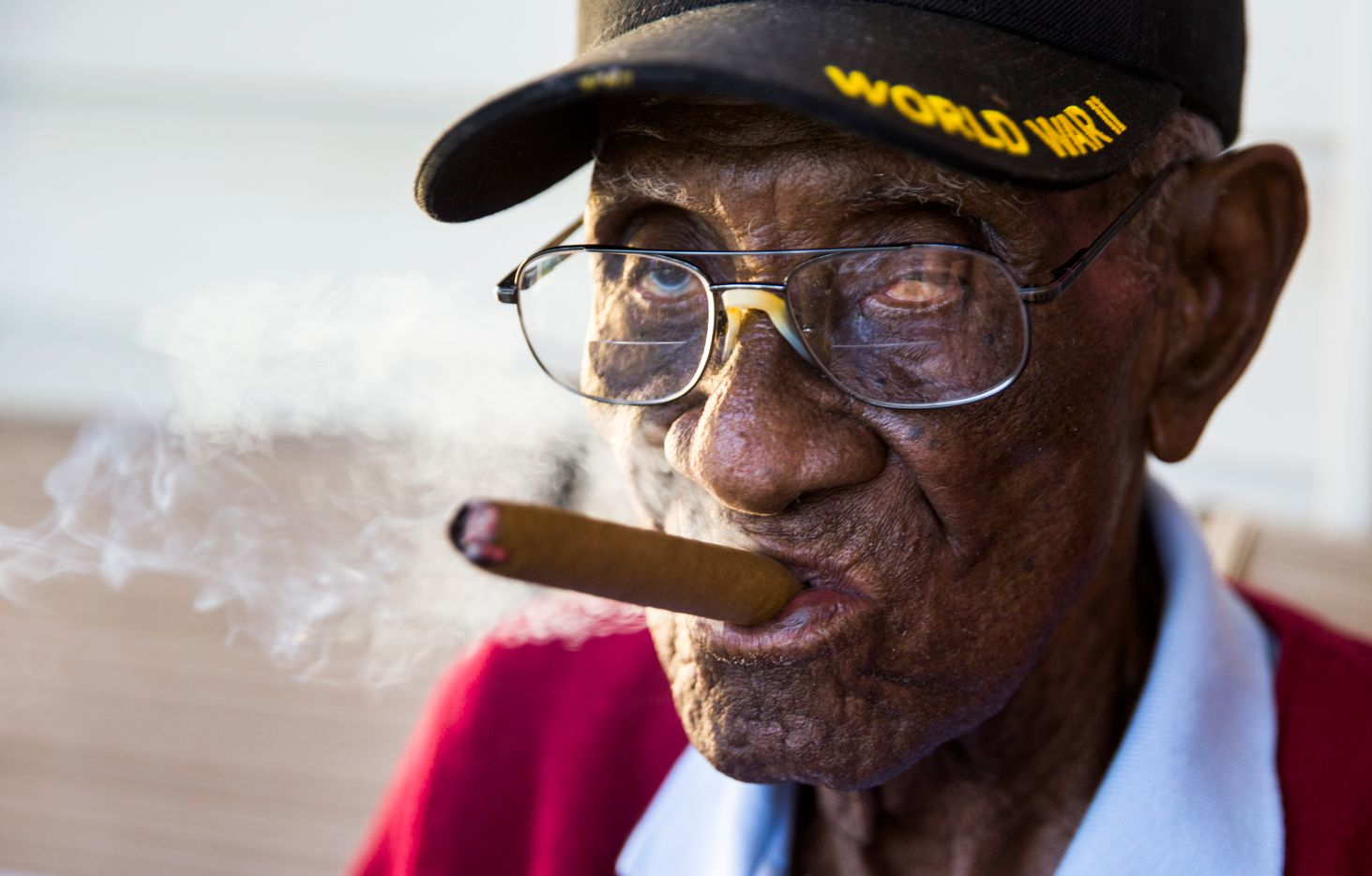 Richard Overton, 111, smokes a cigar on his front porch on Thursday, May 25, 2017, in Austin. Overton is known for smoking cigars and drinking whiskey on his front porch. He is the oldest living U.S. war veteran.