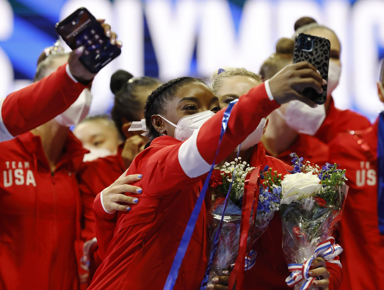 Simone Biles and MyKayla Skinner take a photo together after the women's U.S. Olympic gymnastics team was announced during day 2 of the women's 2021 U.S. Olympic Trials at The Dome at America's Center on Sunday, June 27, 2021 in St Louis, Missouri.(Vernon Bryant/The Dallas Morning News)