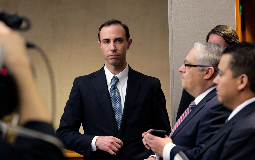 Secretary of State David Whitley, left, arrives for his confirmation hearing, Thursday, Feb. 7, 2019, in Austin, Texas, where he addressed the backlash surrounding Texas' efforts to find noncitizen voters on voter rolls. (AP Photo/Eric Gay)