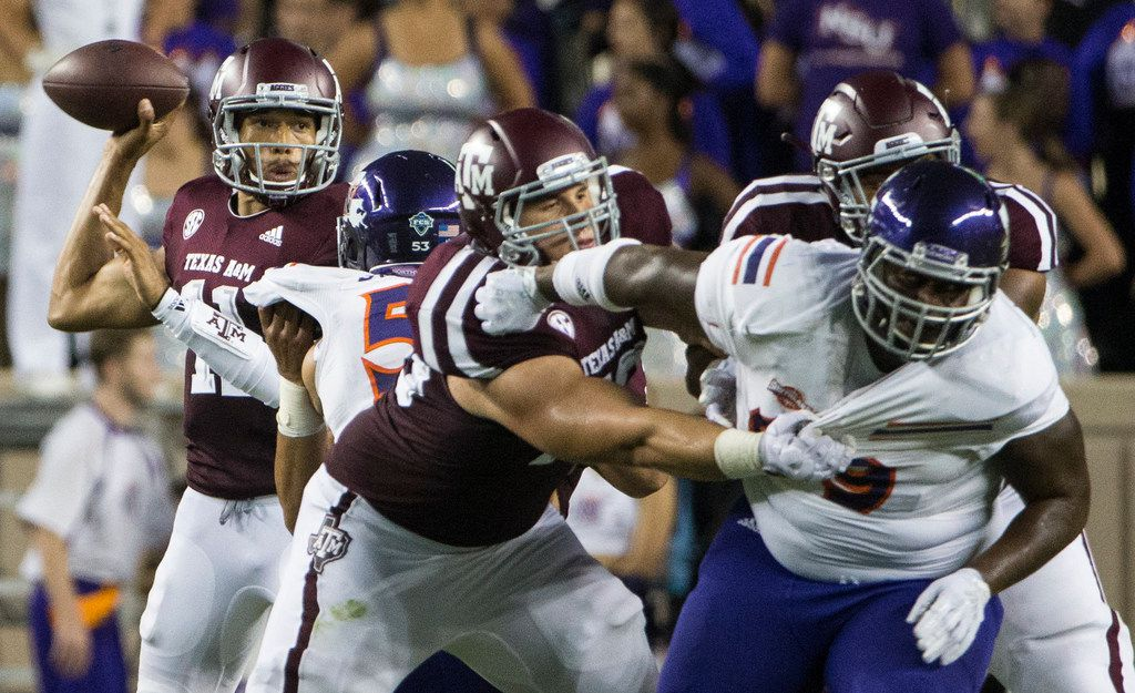 Texas A&M Aggies quarterback Kellen Mond (11) looks to make a pass during a matchup between the Texas A&M Aggies and the Northwestern State Demons on Thursday, August 30, 2018 at Kyle Field in College Station, Texas. (Ryan Michalesko/The Dallas Morning News)