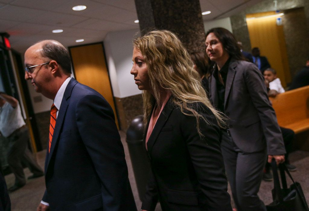 Former Dallas police Officer Amber Guyger (left) departs with her attorneys after making a court appearance at the Frank Crowley Courts Building in Dallas on Thursday, June 6, 2019. Guyger is charged with murder in the Sept. 6 shooting death of Botham Jean in his own apartment.